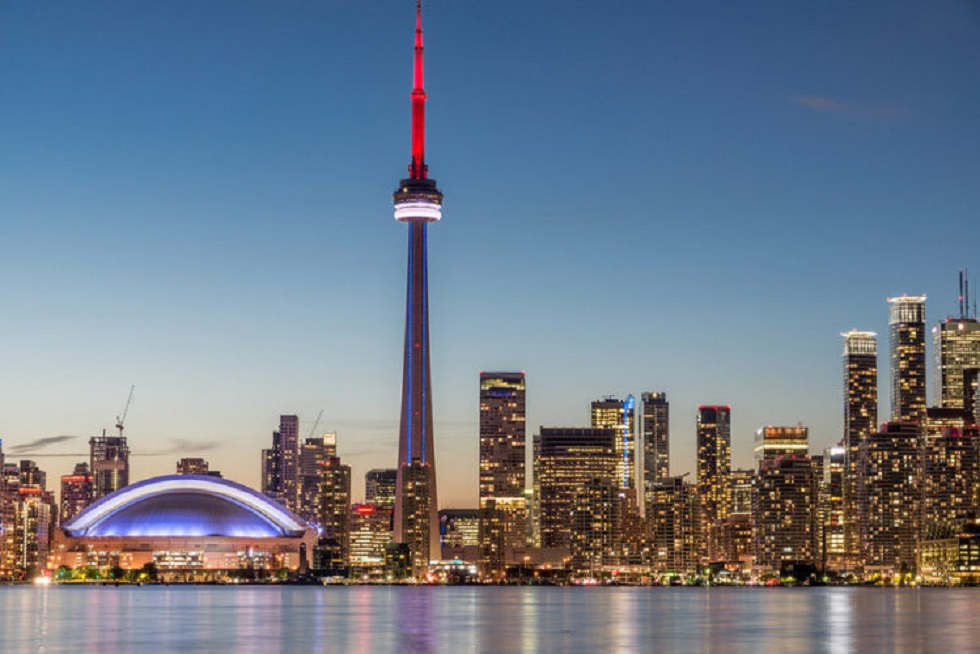 The Toronto skyline with tower during dusk.