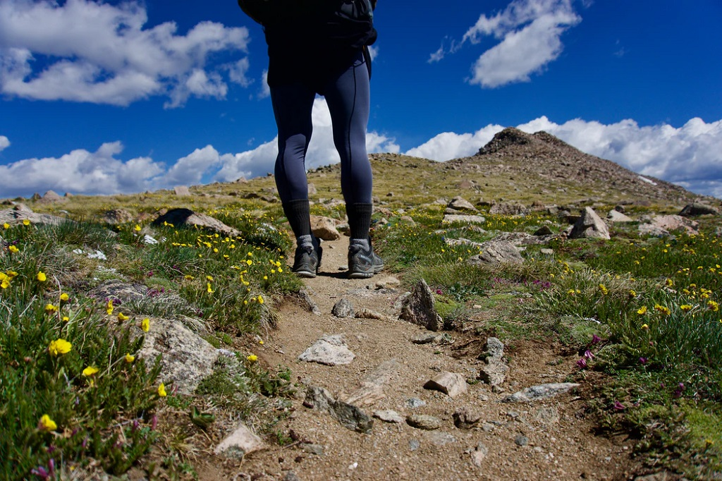 A person walking on a rocky path  Description automatically generated with low confidence